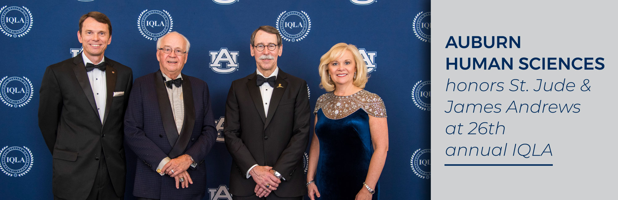 Photo of Bill Hardgrave, James Andrews, James Downing and Susan Hubbard in front of interlocking AU logo on blue background on left side with Auburn Human Sciences honors St. Jude and James Andrews at 26th annual IQLA on right side in blue font on gray backgroun